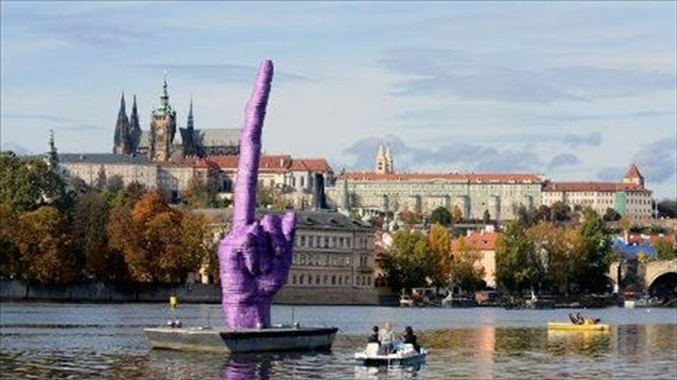 Czech artist gives president 33-foot-high one-finger salute
