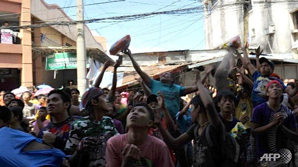 One month after Super Typhoon Haiyan, survivors struggle to put their lives back together