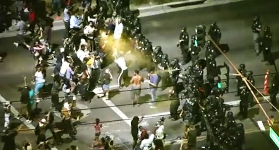 WATCH: Phoenix police in riot gear hose down anti-brutality protestors with pepper spray