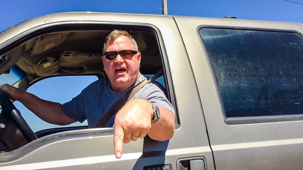 Raging anti-Hillary nut faces assault charges for trying to run over photographer with SUV
