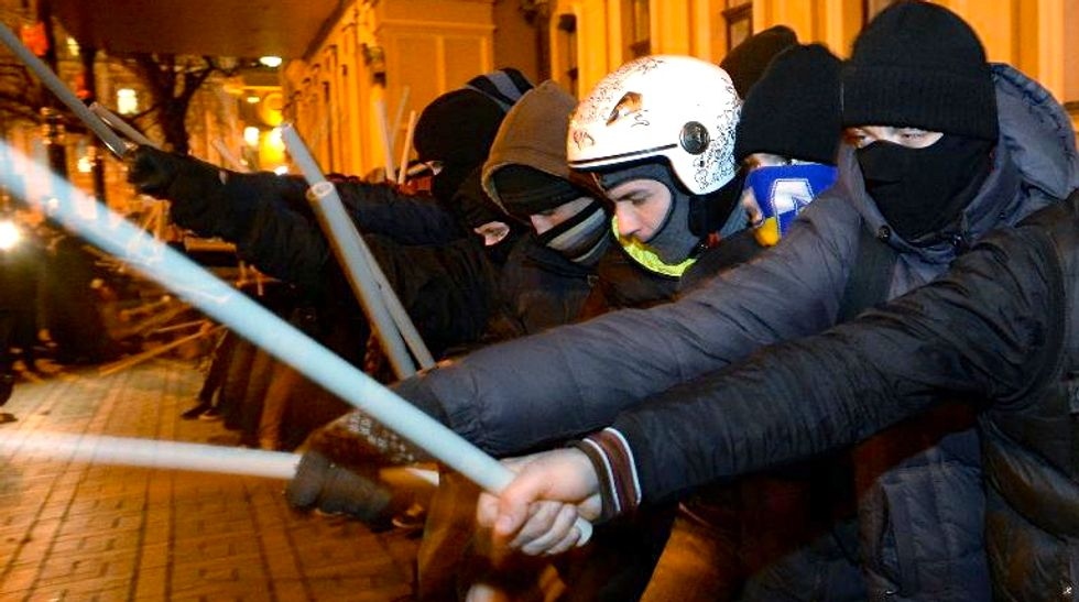 EU suspends work on trade pact with Ukraine, protests continue
