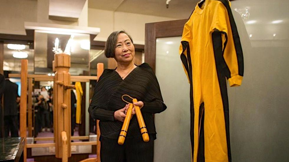 Bruce Lee's famous yellow-and-black jumpsuit fetches more than $100,000 in Hong Kong auction