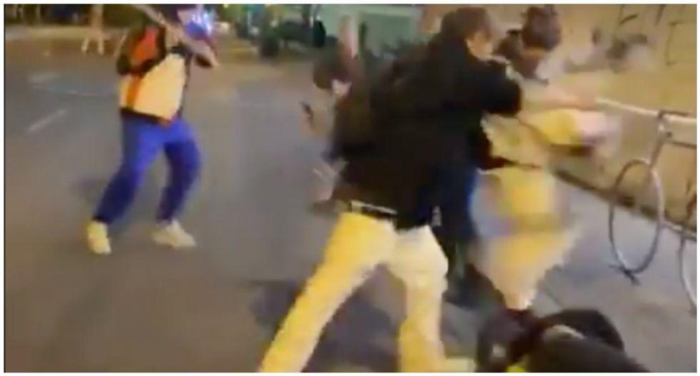 WATCH: White men brandishing machete attack and beat nonwhite protester in Minneapolis