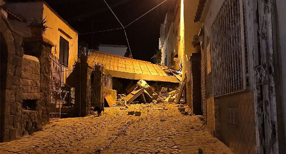Two dead, children trapped after earthquake hits Italy holiday island