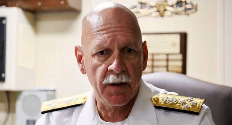 US admiral says remains found inside damaged destroyer