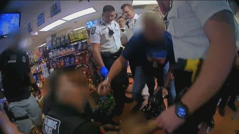 WATCH: Ohio cop threatens to 'choke the life out of' man in custody