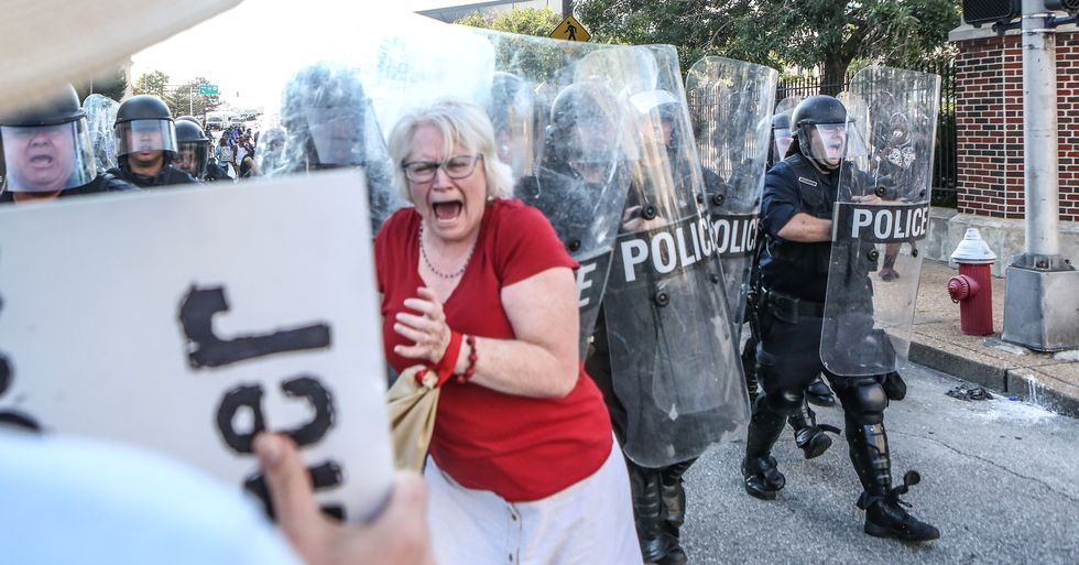 Protesters march through St. Louis after policeman's acquittal in fatal shooting of black man