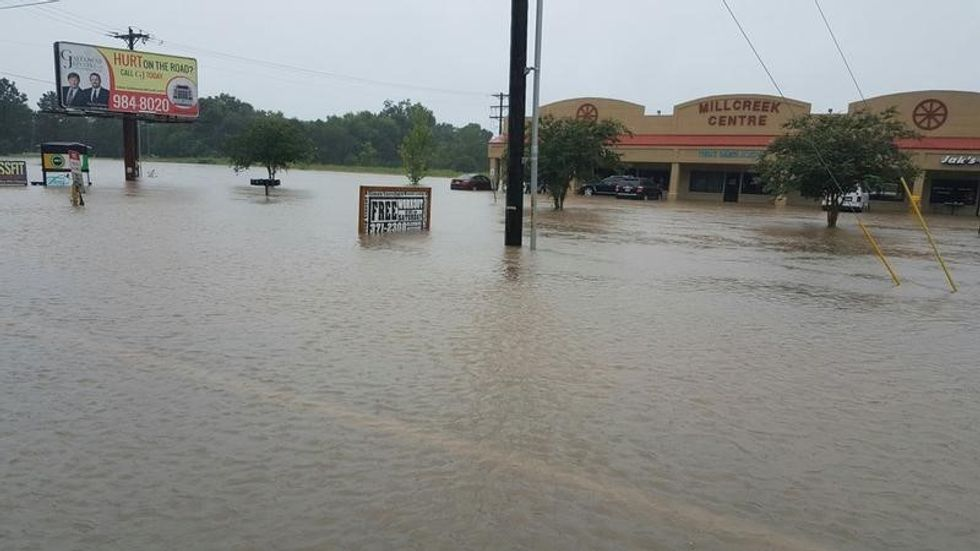 At least three dead as 'unprecedented' flooding slams U.S. Gulf Coast
