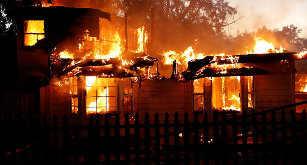 Rampaging wildfire rages into California town -- burning homes and businesses