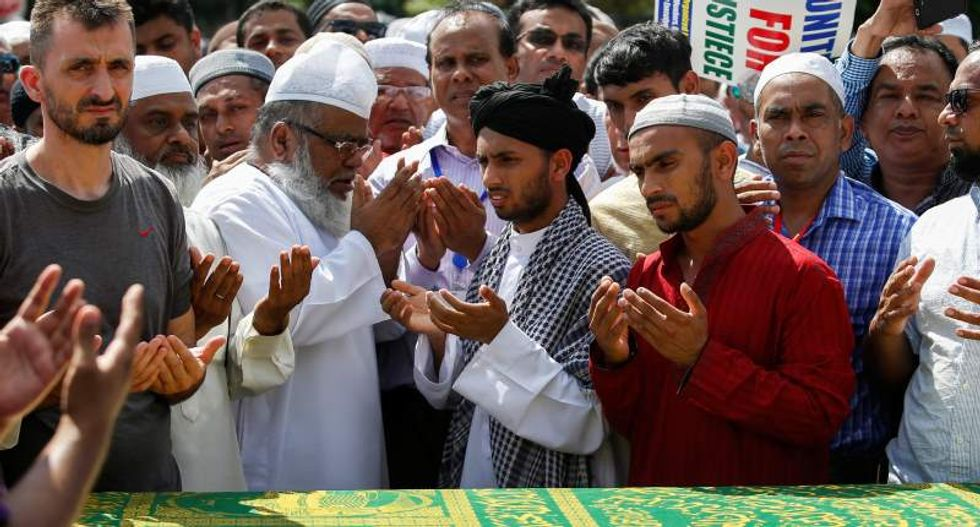 Thousands mourn slain New York imam as police arrest and question Brooklyn man