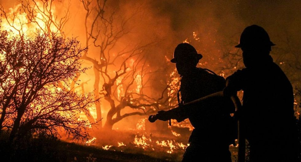 More than 82,000 flee rapidly spreading wildfire in southern California
