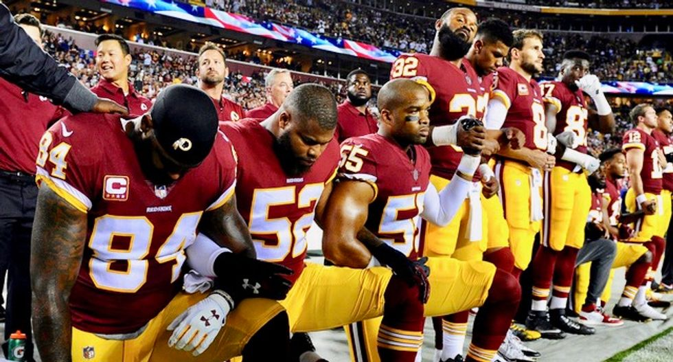 A majority of adults disagree with Trump on firing athletes who kneel during anthem: Reuters/Ipsos poll