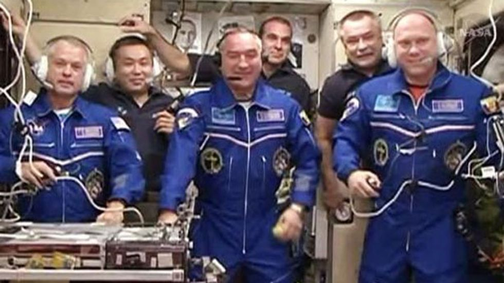Russian-US crew docks at space station two days late after technical glitch