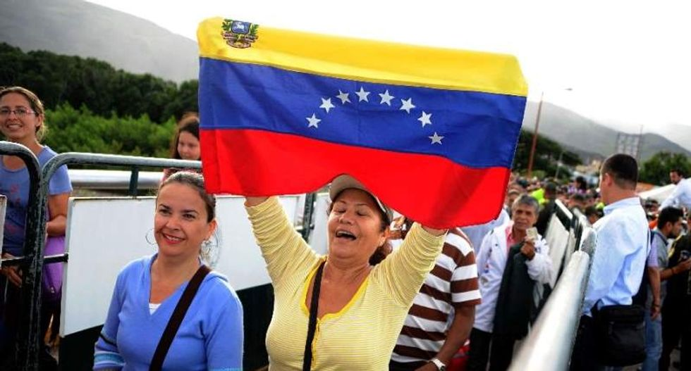 Venezuelans pour into Colombia again to buy necessary supplies as border reopens