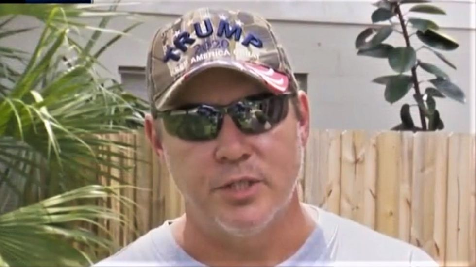 Trump supporter brags that he 'went to jail for our president' after punching Biden-backing neighbor