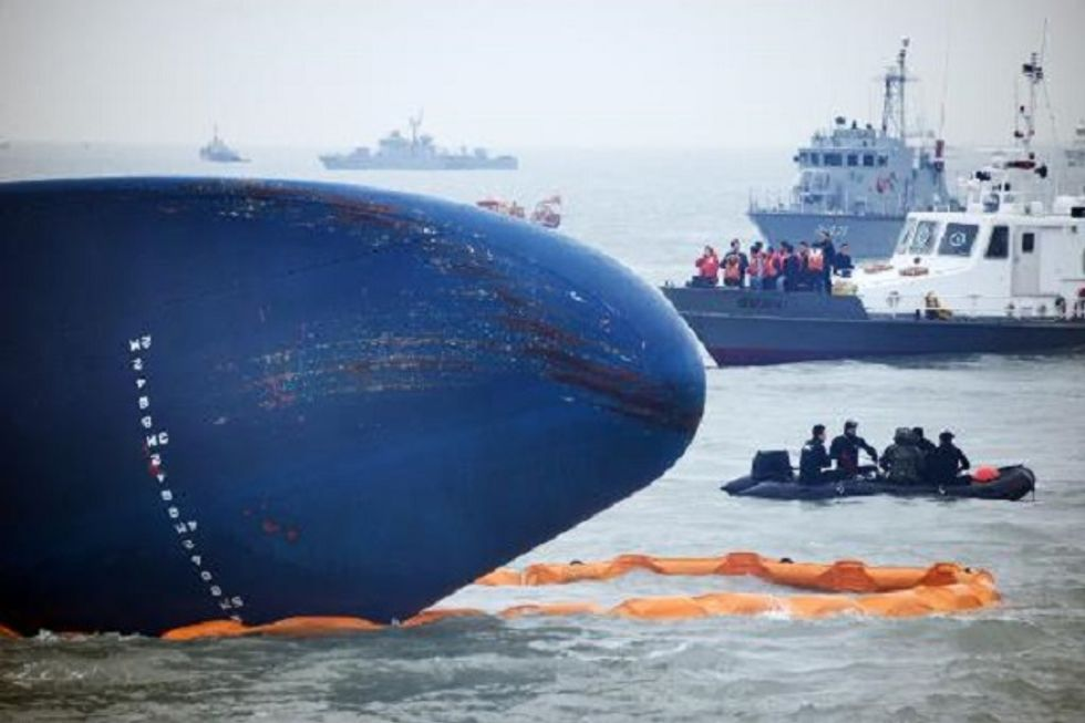 South Korea ferry captain defends actions, bodies seen in ship