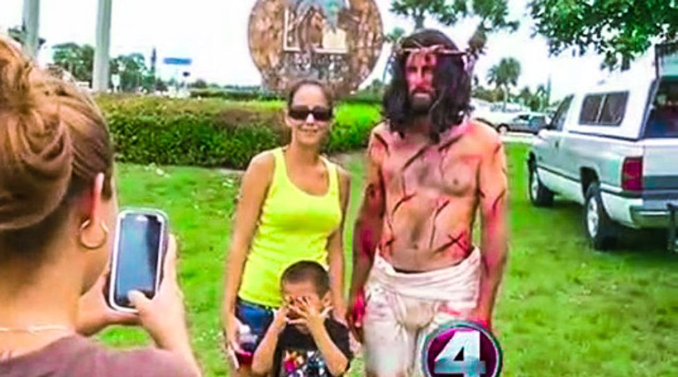'Bloody Jesus' actor ordered down from roadside cross for endangering drivers in Florida