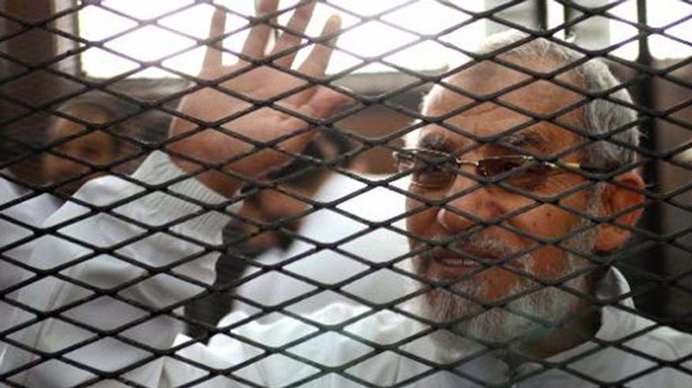 Egypt court sentences 683 to death including Muslim Brotherhood leader