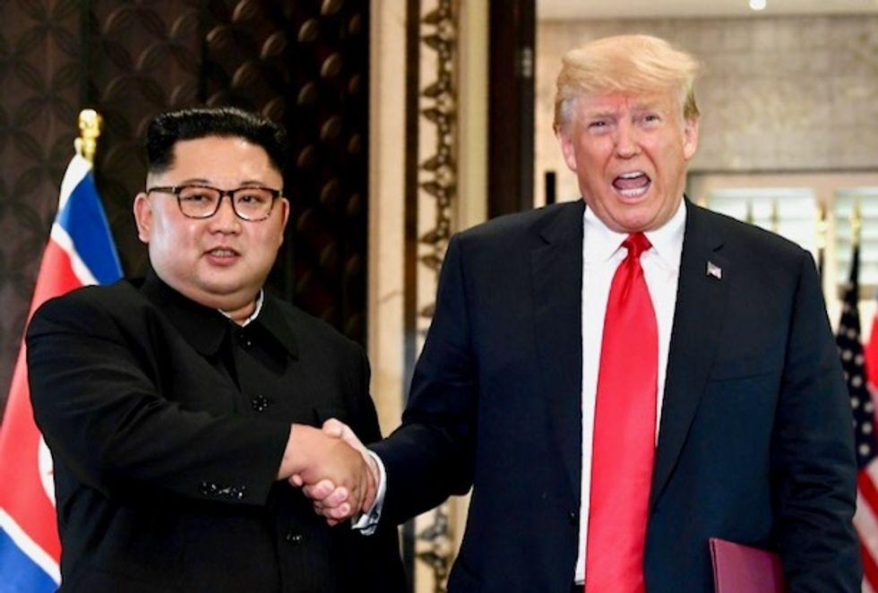 Trump says North Korea talks going ahead despite missile test