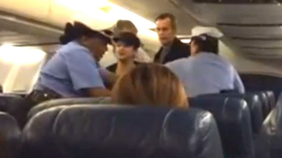 WATCH: Irate woman on wrong flight accuses cops escorting her of being 'f*cking racist bigots'