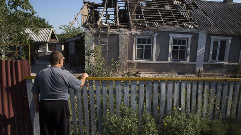 Clashes kill two in east Ukraine as UN warns of mass exodus