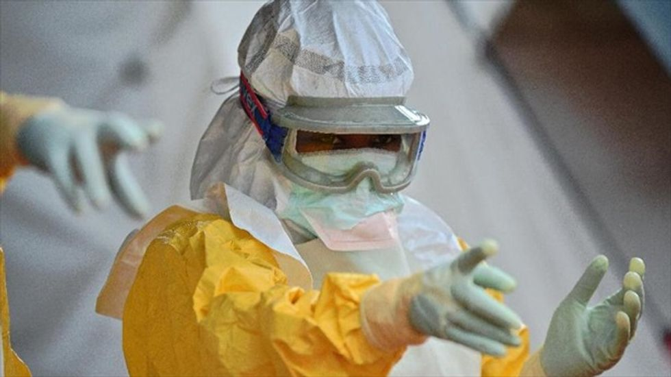 Liberia's chief medical officer puts herself in quarantine after assistant dies of Ebola
