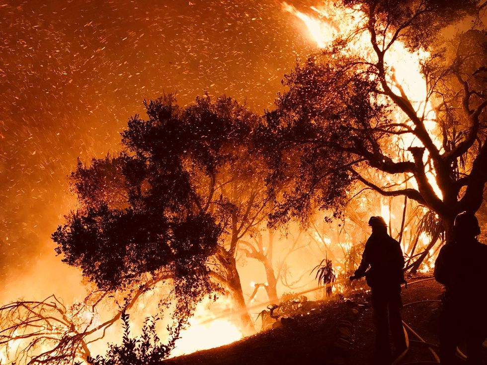 California wildfire rages toward scenic coastal communities