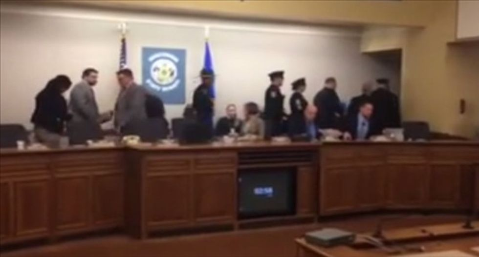 Watch Wisconsin GOP lawmakers walk out to escape public outcry against 'right-to-work' bill