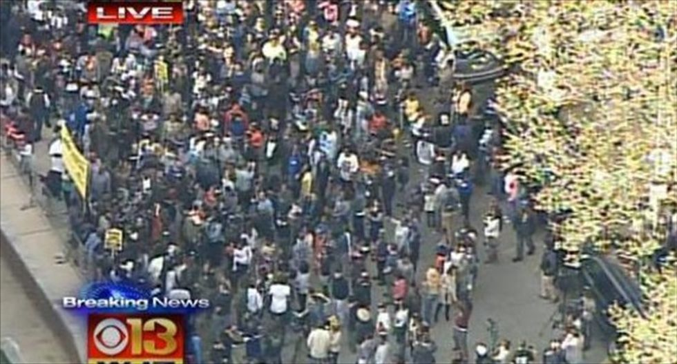 Hundreds of protesters march in Baltimore as Justice Dept. announces probe of Freddy Gray's death