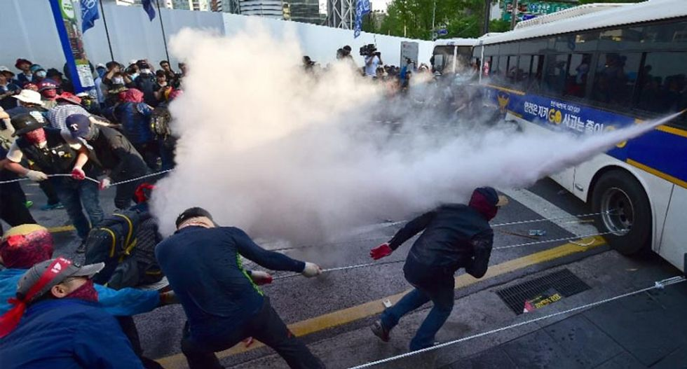 May Day rallies in Asia as South Koreans clash with police