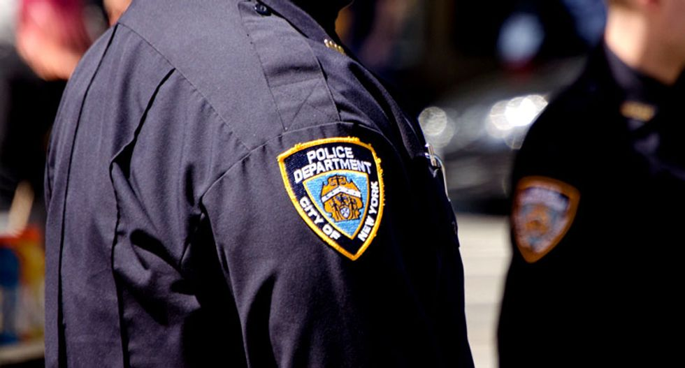 NYPD officer Brian Moore dies after being shot in head