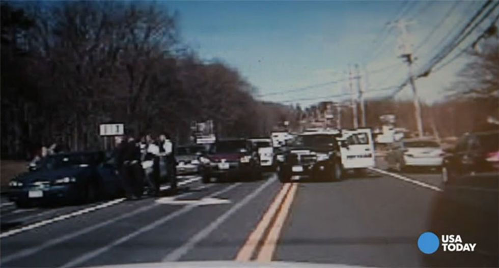 Video shows four parole officers detained by gun-wielding police for Driving While Black