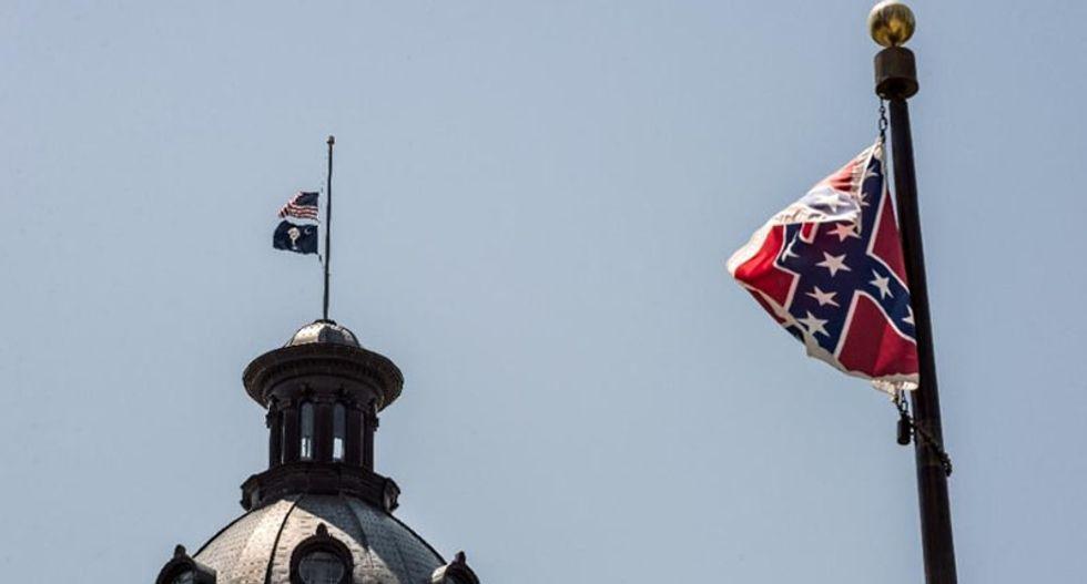 Confederate flag, despite racist church massacre, still flies high in South Carolina