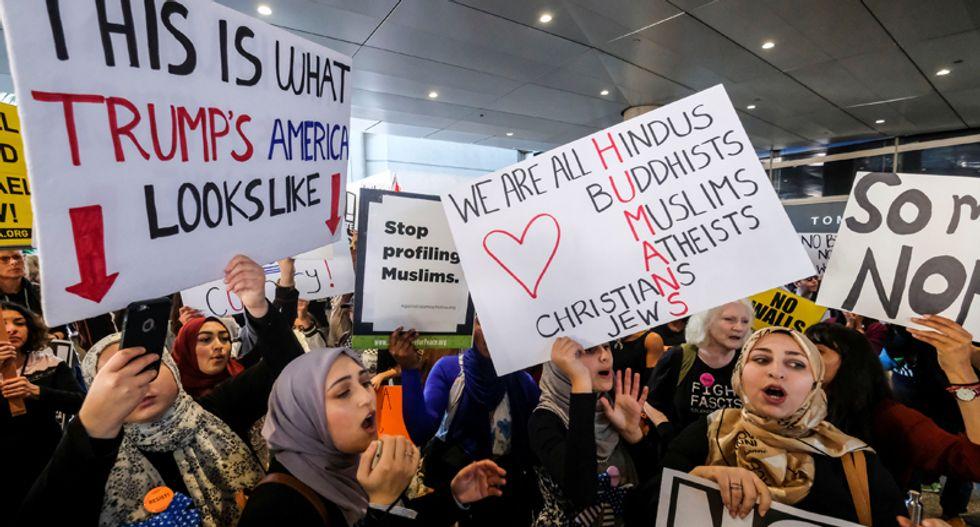 Travellers rush to board U.S. flights while Trump ban blocked