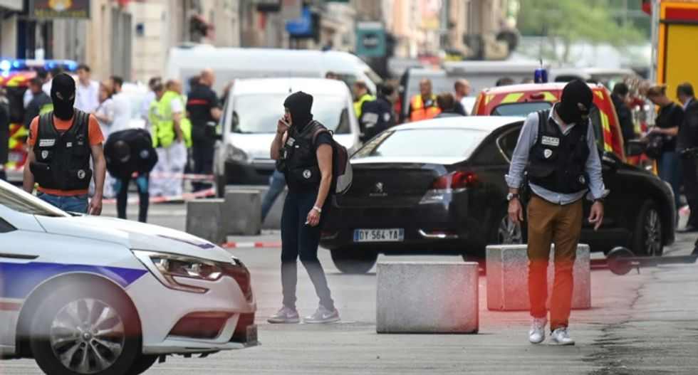 French police arrest four over Lyon package bomb blast