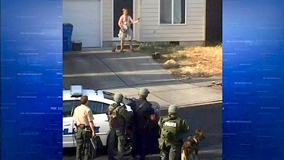 Naked, banjo-playing Washington man taken into custody after two-hour standoff with police