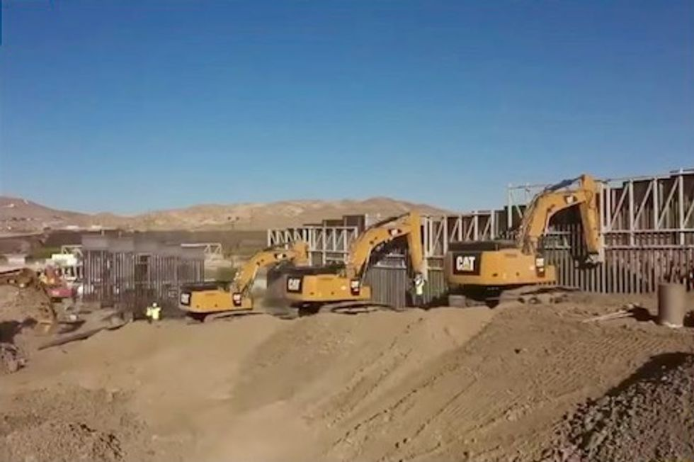 Private group backed by Trump supporters builds border barrier in El Paso