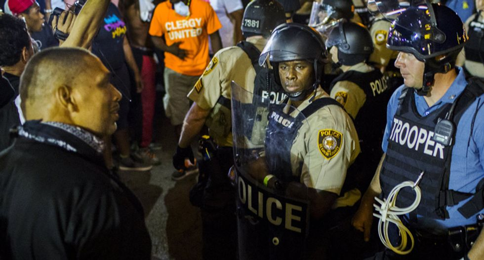 'Militaristic' Oath Keepers patrol Ferguson streets to 'protect' InfoWars journalist working for Alex Jones
