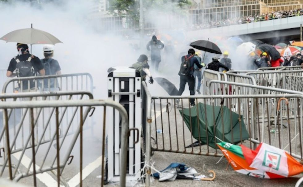 Hong Kong protesters plan weekend rally after violent clashes