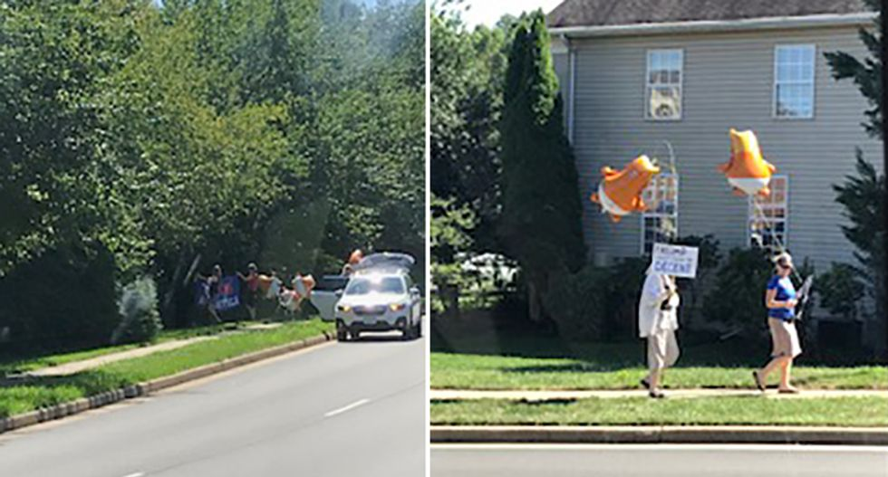 Protesters at Trump golf club greet presidential motorcade with cry-baby balloons and 'Putin's Apprentice' signs