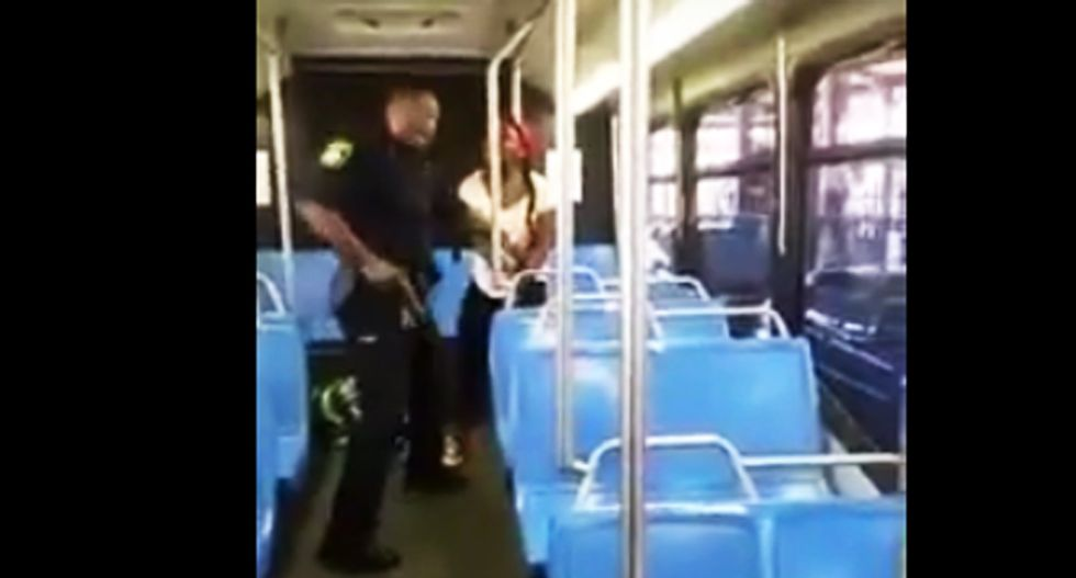 WATCH: Boston cop arresting black woman holsters weapon after witnesses beg him 'drop the gun'