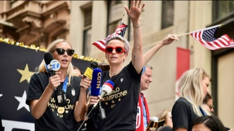 Confetti and chants of 'equal pay' greet US World Cup winners