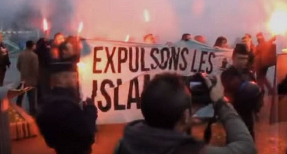 WATCH: French mourners angrily chase off right-wing anti-Muslim bigots invading vigil