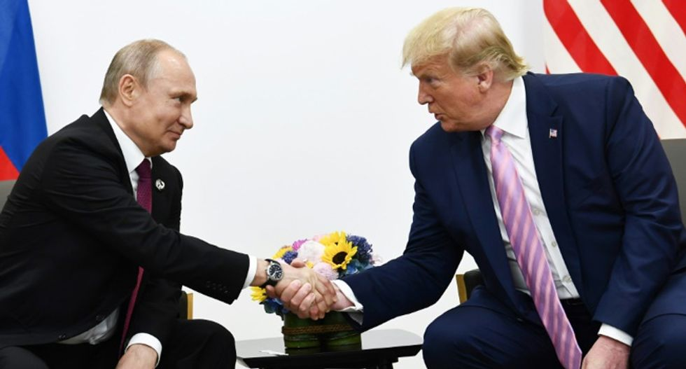 Internet explodes over news that Putin is planning to sabotage the election for Trump — yet again