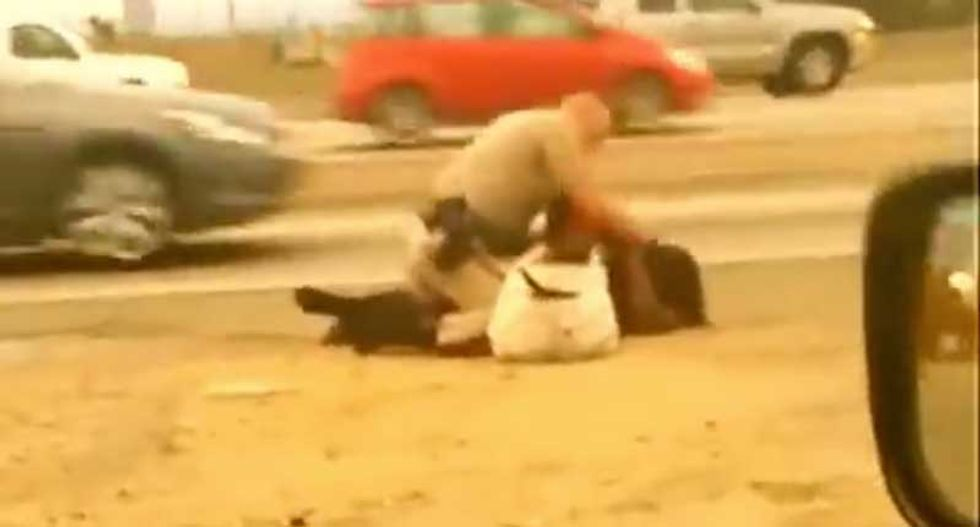 Cop escapes charges for bashing in woman's face -- because he was 'protecting' her
