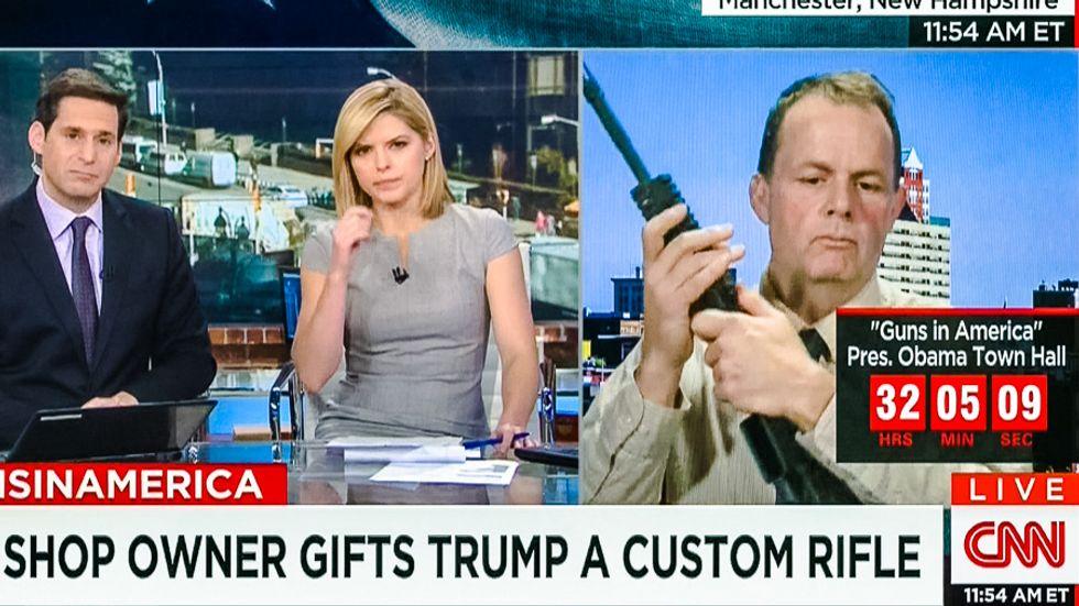 'Really?': Trump-loving gun shop owner shocks CNN hosts by cradling AR-15 for entire bizarre interview