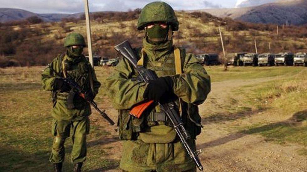 Ukraine says 100,000 Russian troops have amassed near border