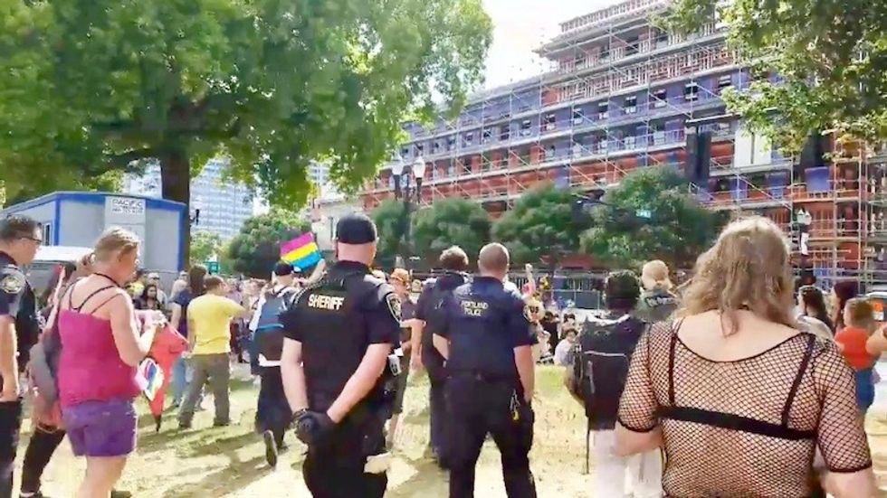 Cops force anti-gay protestors away from Portland Pride parade after reported tear gassing