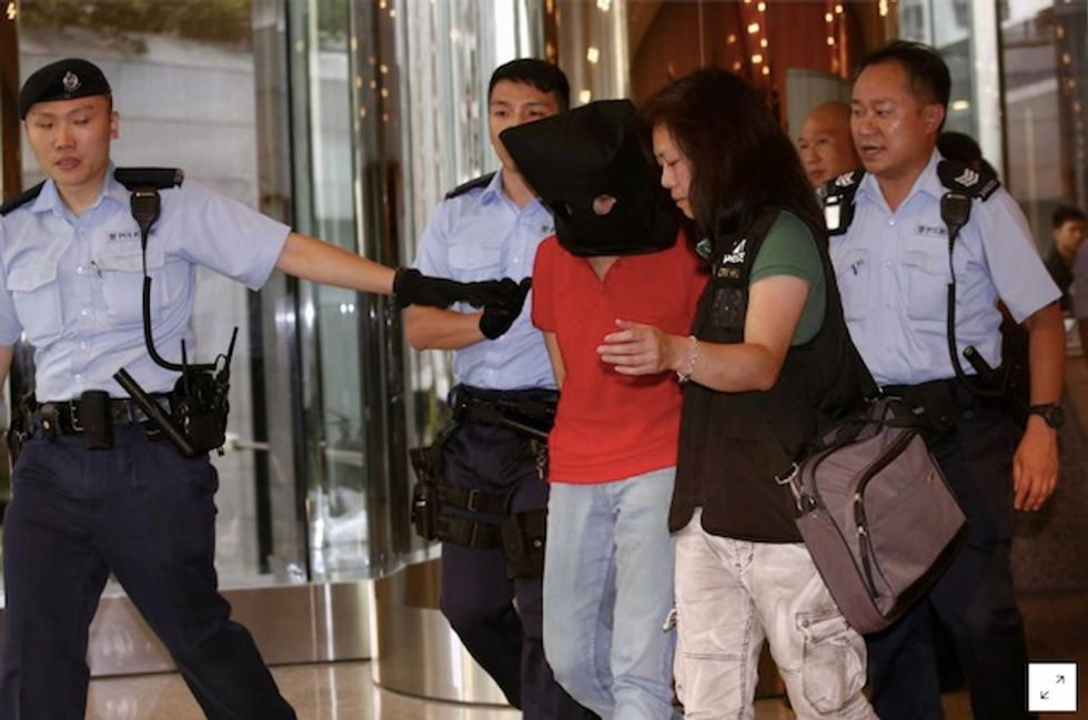 Four people wounded in rare Hong Kong shooting; woman arrested