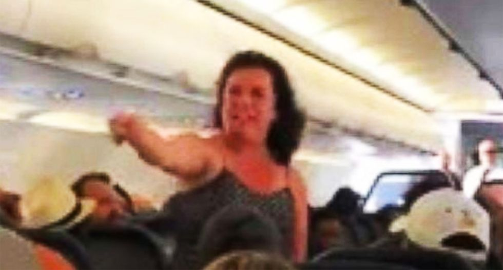 WATCH: Police called after woman has profanity-laced meltdown on flight diverted for medical emergency